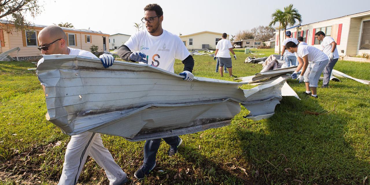 hero-hurricane-cleanup-volunteers-habitat-hammers-back